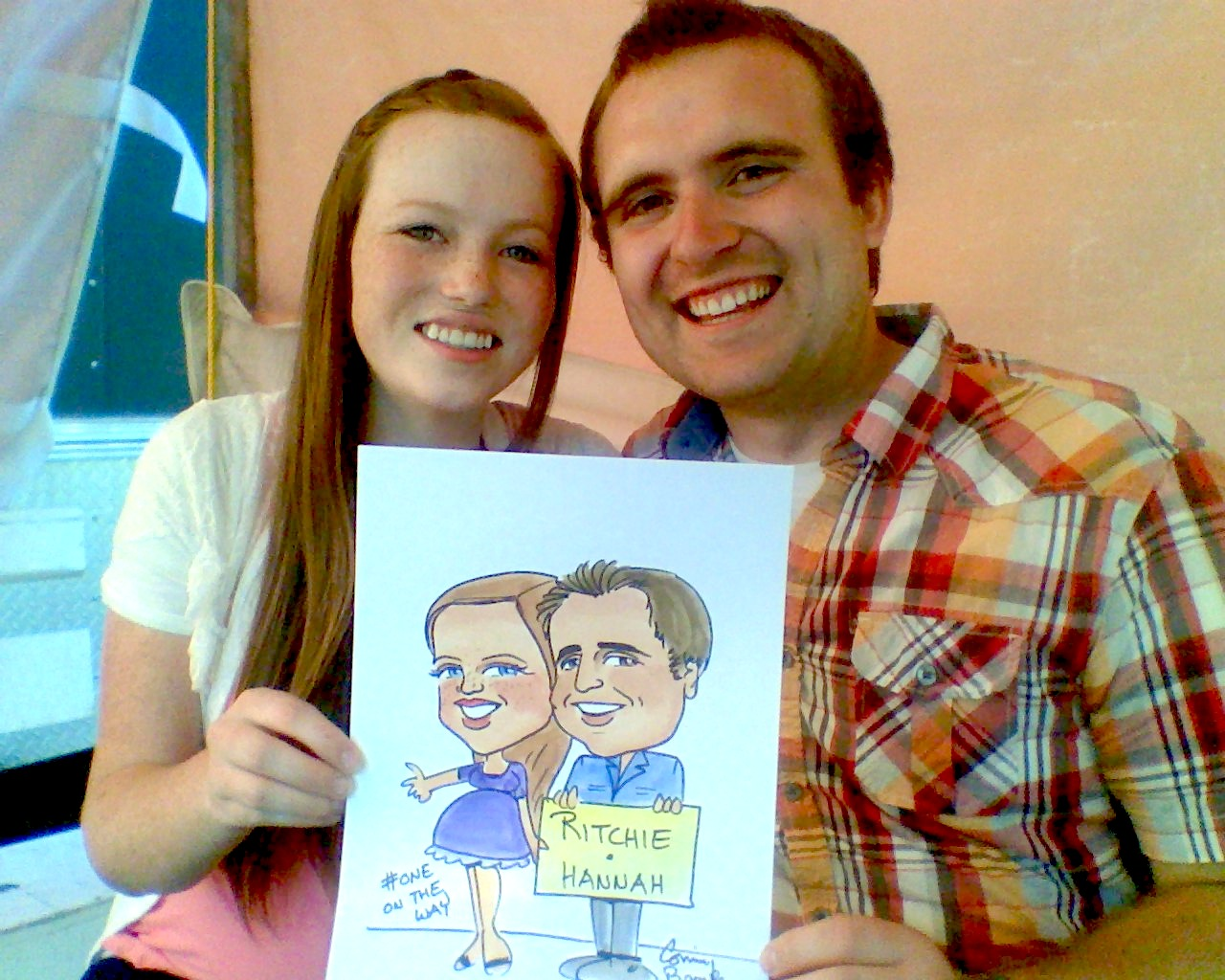 Couple holding caricature sketch